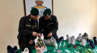 Catania. Sequestrati all'interno di un abitazione scarpe e 3.500 etichette contraffatte. Denunciati 3 cittadini stranieri